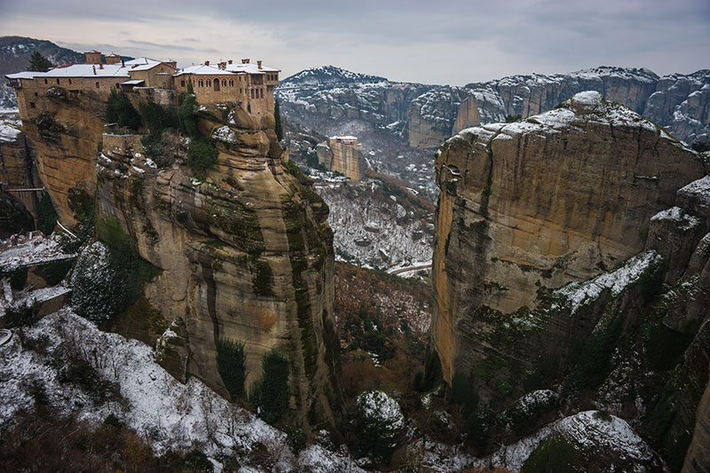 Scenic views of the mountains and monasteries of Meteora in winter