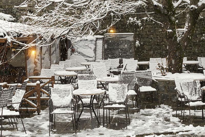 Tables ice snow, Metsovo city, Greece